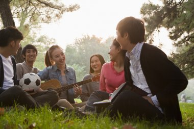 Teenagers hanging out in the park