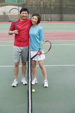 Couple into the tennis net