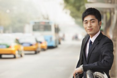 Businessman waiting at the bus