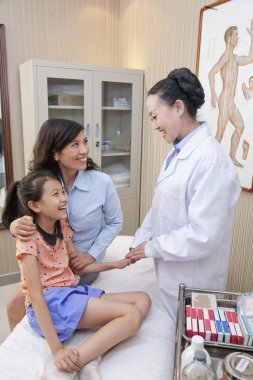 Doctor Talking with Mother and Daughter