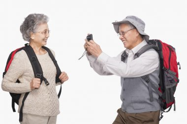 Senior man taking wife's picture