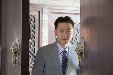 Businessman in Doorway