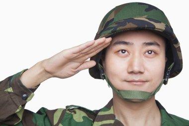 Man in military uniform saluting