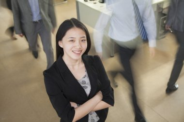 Businesswoman smiling in the office