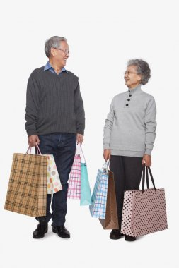 Senior couple with shopping bags