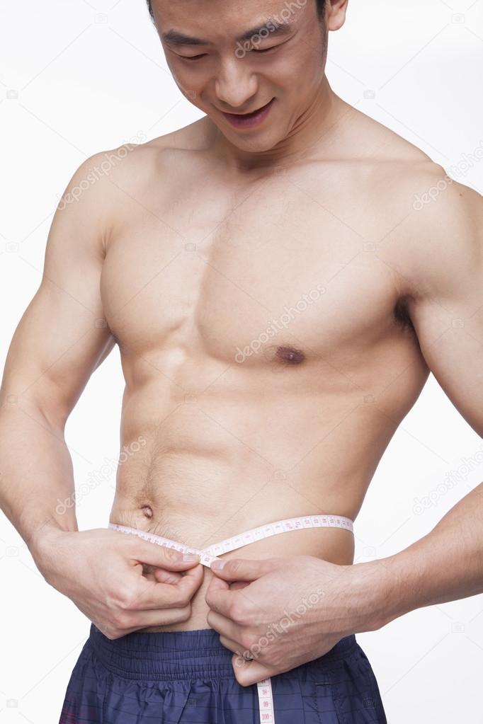 3e4da8eb1 cintura de medição de homem sem camisa — Fotografias de Stock ...