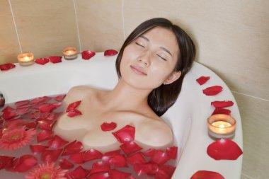 Woman Bathing at Health Spa