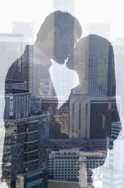 Couple kissing over cityscape
