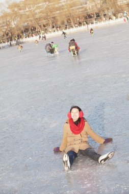 Woman Falling While Ice Skating