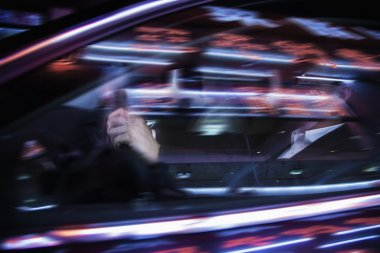Businessman driving at night,