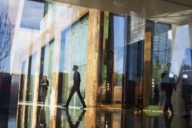Business People walking through the lobby of an office building