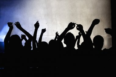 Crowd of young people dancing in a nightclub