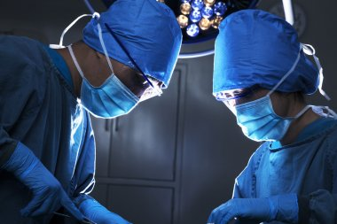 Two surgeons concentrating at the operating table