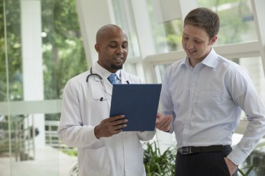Doctor and patient discussing medical record