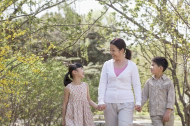 Grandmother with her two grandchildren in the park