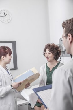 Doctors discussing with a patient