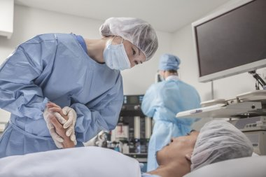 Surgeon consulting a patient