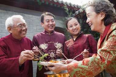 Family enjoying Chinese meal
