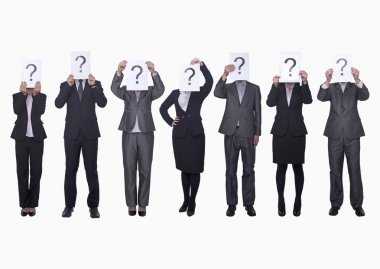Business people holding up paper with question mark