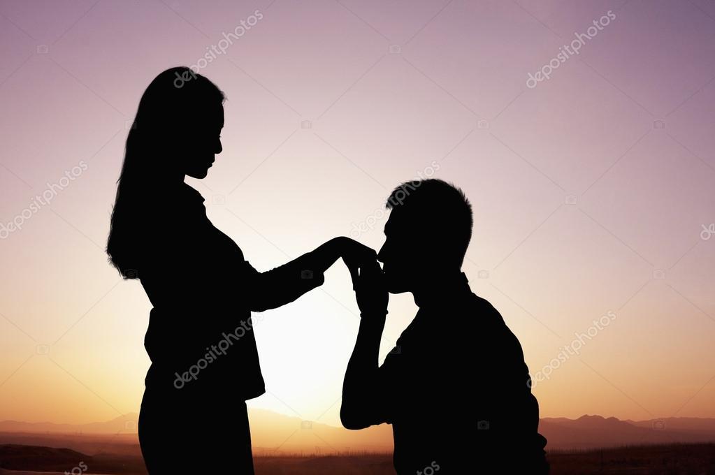 https://st.depositphotos.com/2923727/3665/i/950/depositphotos_36657307-stock-photo-silhouette-of-boyfriend-kneeling-and.jpg