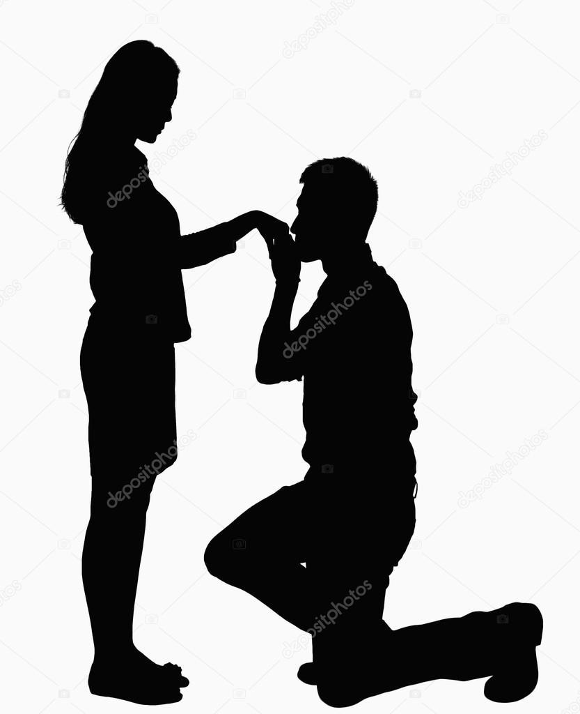 Silhouette der Mann auf die Knie, Frau Hand küssen ...