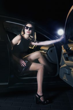 Woman stepping out of the car