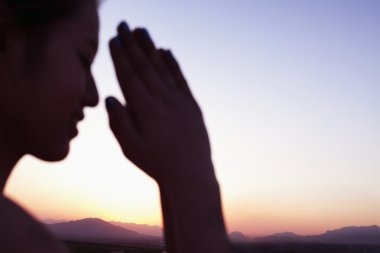 Woman hands together in prayer pose