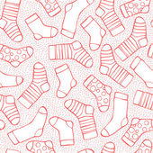 Fotografie Seamless background with socks and snowflakes for winter and christmas theme