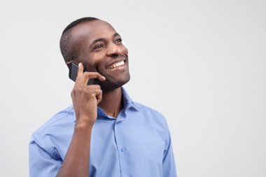 Black man talking on the mobile phone and smiling
