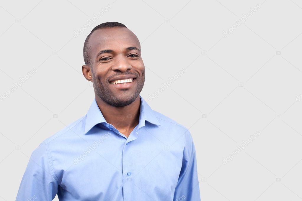 Young black man smiling at camera