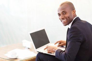 Businessman typing something on laptop