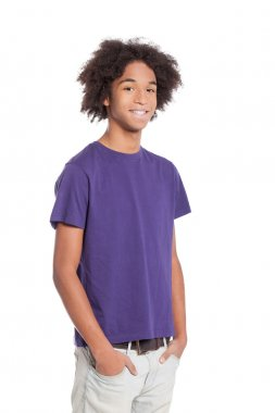 Smiling African young teenage boy holding hands in pockets