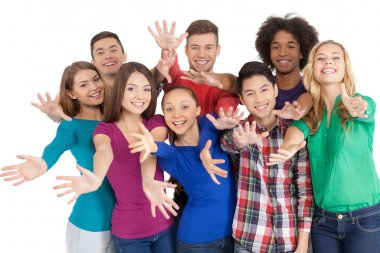 Multi-ethnic people standing close to each other and gesturing