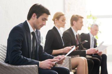 Four people in formalwear waiting in line