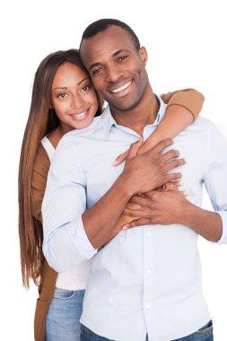 Beautiful young African woman hugging her boyfriend
