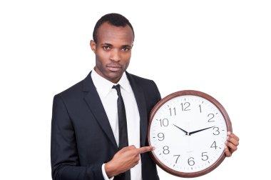 African man holding clock