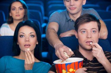 Stealing popcorn.