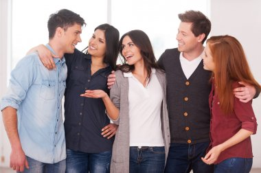 Group of cheerful young people standing close to each other