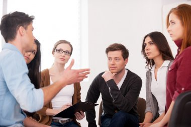 Man telling something for group of people