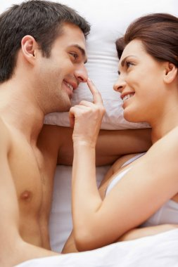 Playful couple in bed