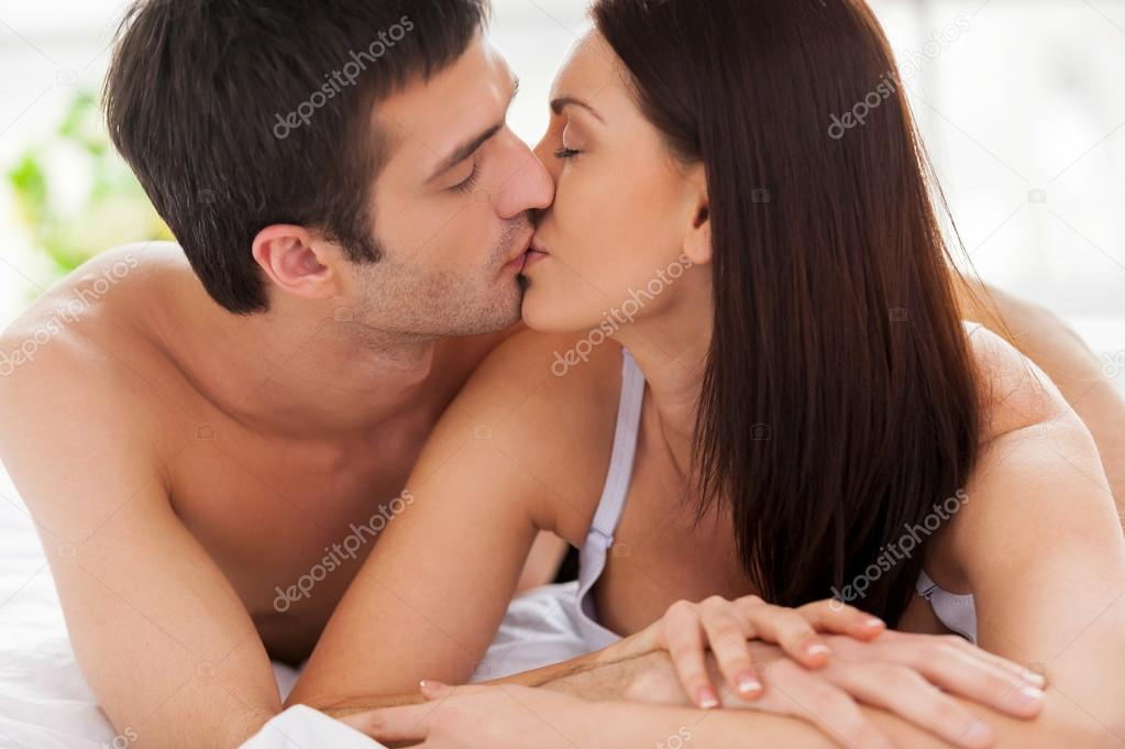 Loving Couple Kissing In Bed U2014 Stock Photo
