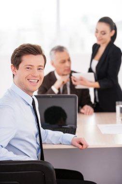 Man in formalwear looking over shoulder