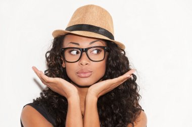 African woman in glasses and funky hat