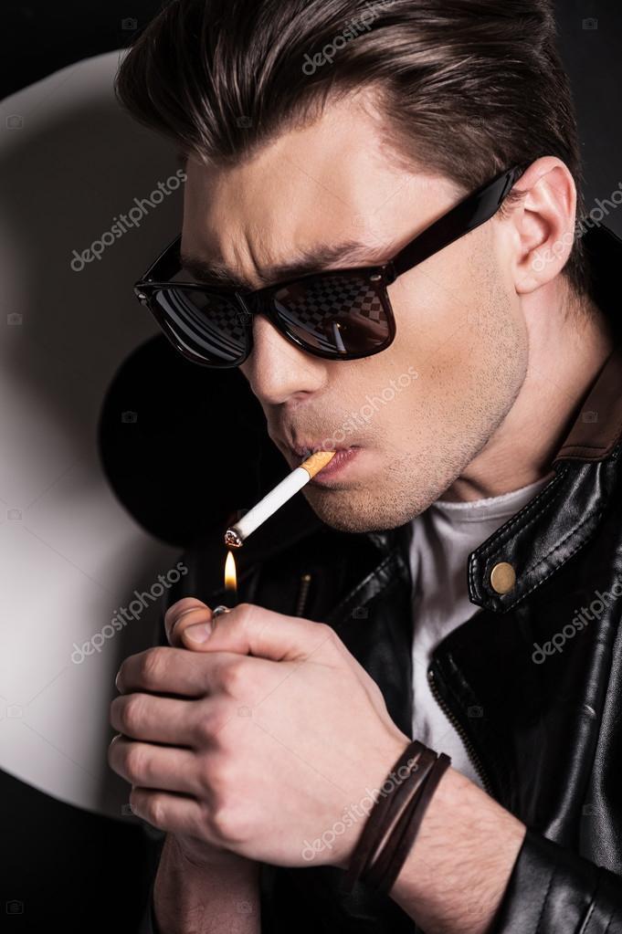 Male model lighting a cigarette u2014 Stock Photo #45040175  sc 1 st  Depositphotos & Male model lighting a cigarette u2014 Stock Photo © gstockstudio #45040175 azcodes.com