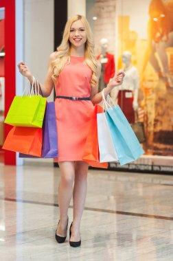 Happy woman shopping.