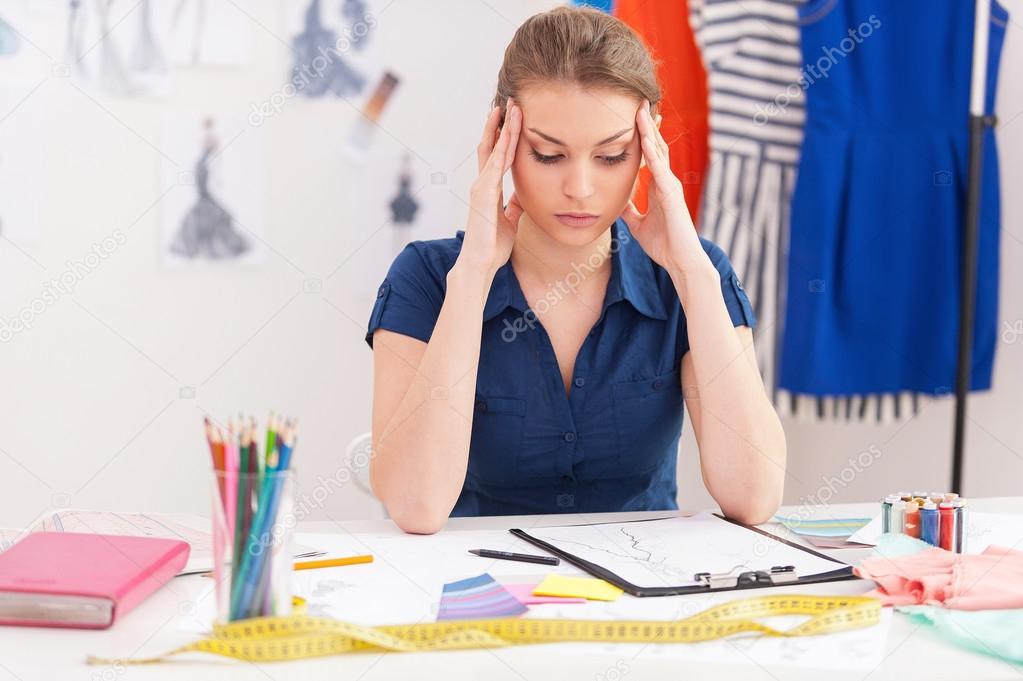 Fashion Designer Holding Head In Hands Stock Photo C Gstockstudio 45540739