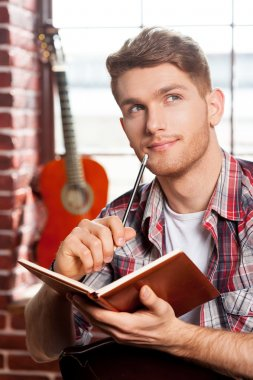 Man writing something in note pad