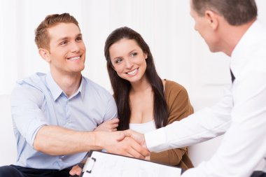Man shaking hand to financial agent