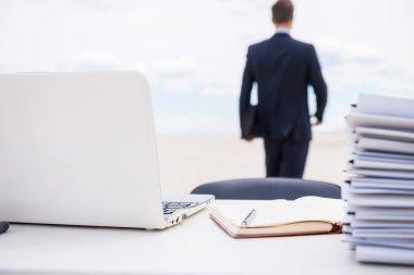 Man in formal wear walking away from working place