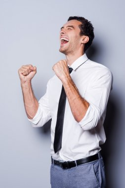Happy young man in shirt and tie